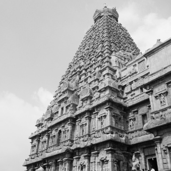 The small cap-lookalike on top alone weighs 80 tonnes and the whole thing stands together without glue. Big Temple, Thanjavur, India. Shot with One Plus X phone camera.
